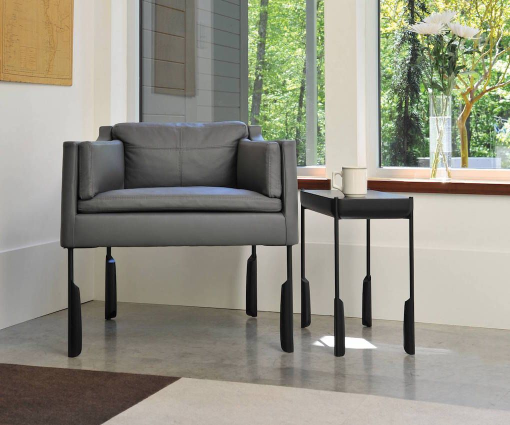 The Altai Easy Chair Upholstered In Napa Leather With Tail Table