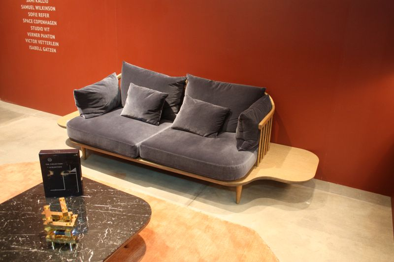 Sofa with built in base for tv remotes