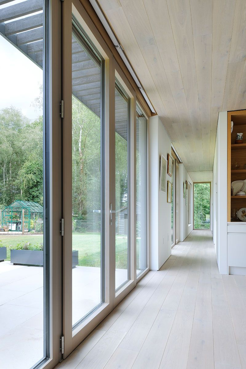 Sustainable mobile home in UK hallway windows