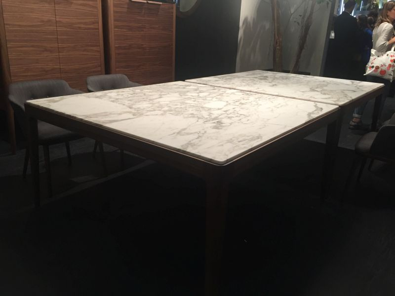 Wood dining table base with marble on top. A Trip Into The World Of Stylish Dining Tables