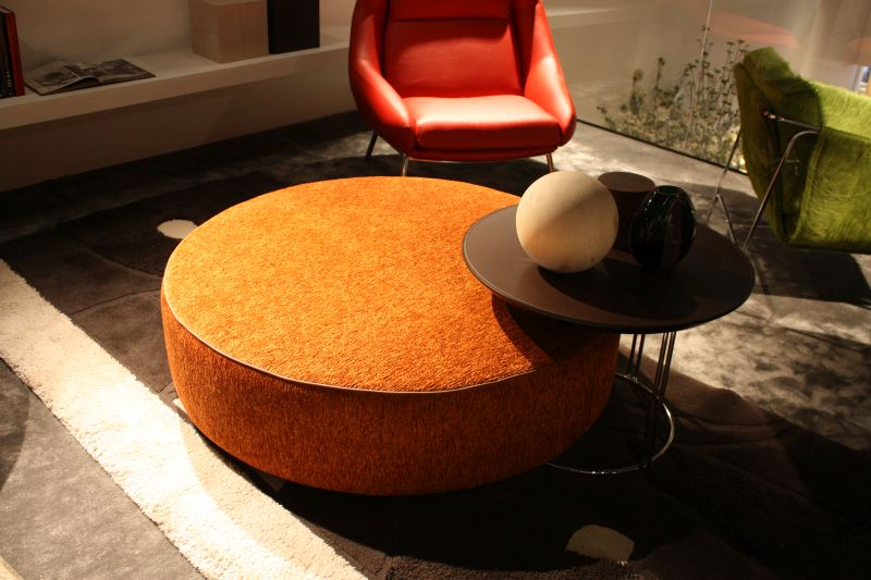 orange ottoman with tray table
