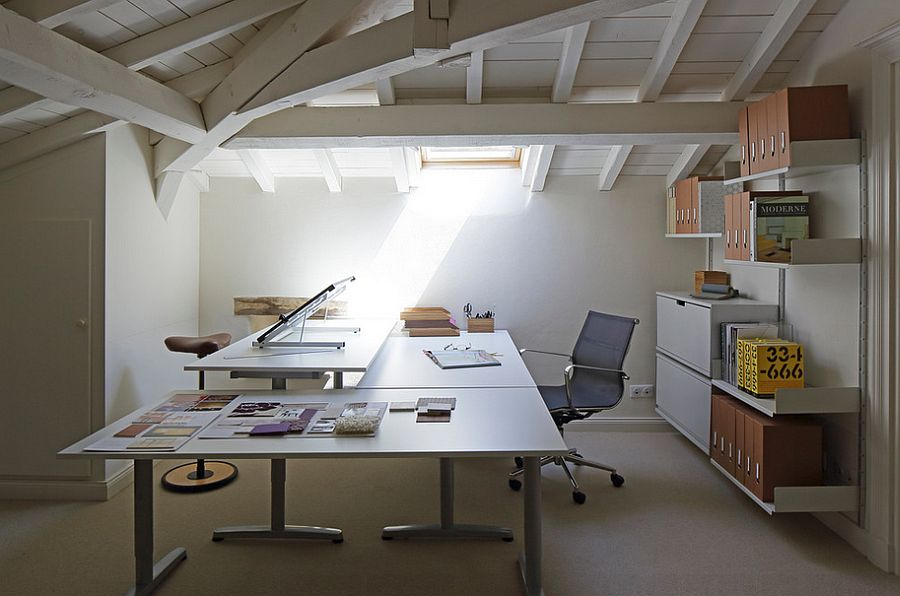 Attic office room with a ceiling window