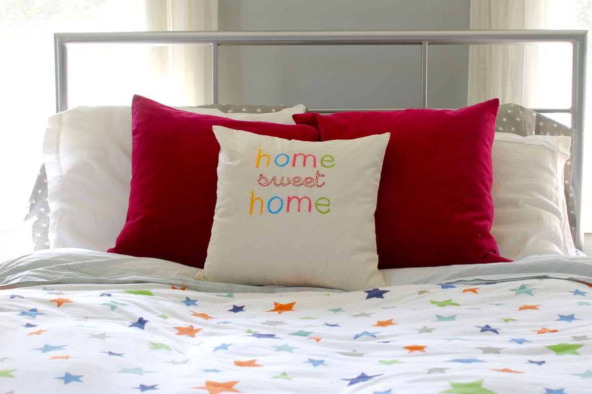 bed-embroidered-home-sweet-home-throw-pillow