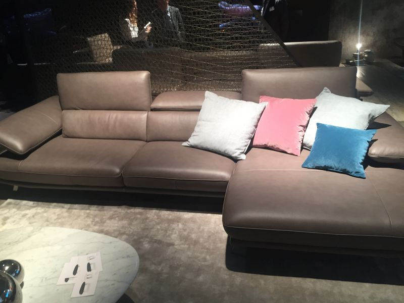 brown-leather-sofa-with-throw-pillows