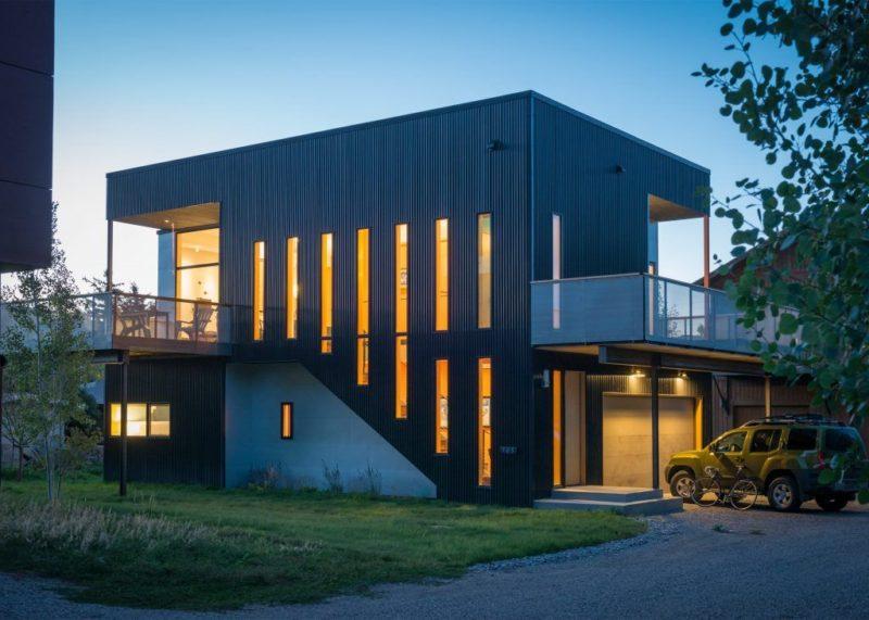 Box-Like Home With Narrow Windows And A Climbing Wall