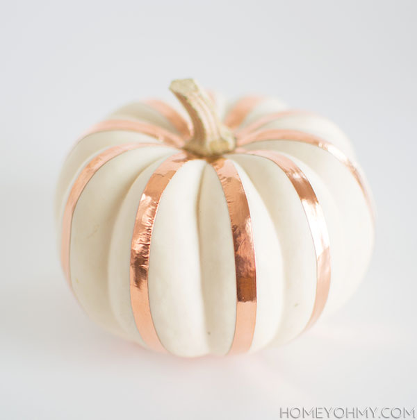 Decorate the pumpkin with tape