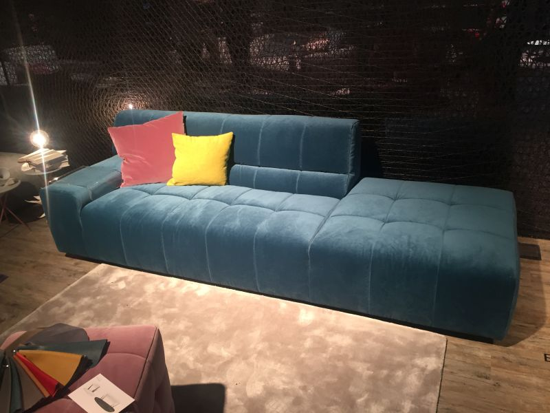 deep-blue-couch-with-decorative-pillows