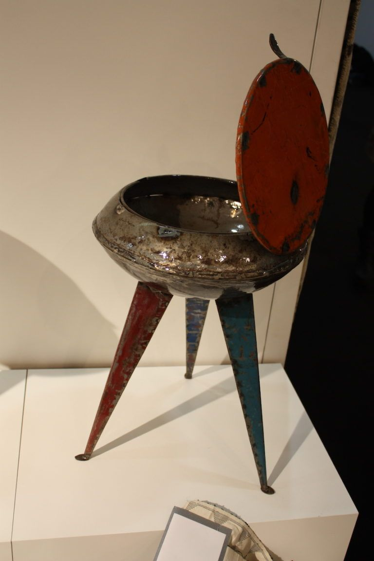 His artful metal stool has concealed storage.