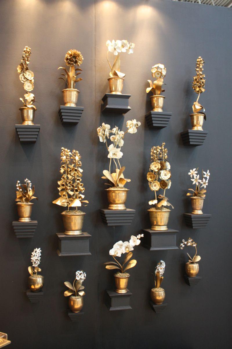 gold-sprayed-flowers-used-like-wall-art