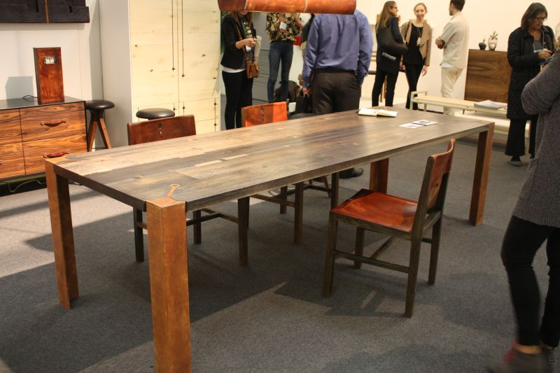 Large dining table with leather detail