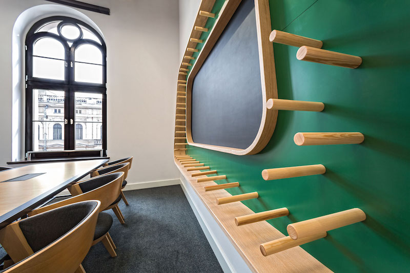 Opera office meeting room with colored peg wall