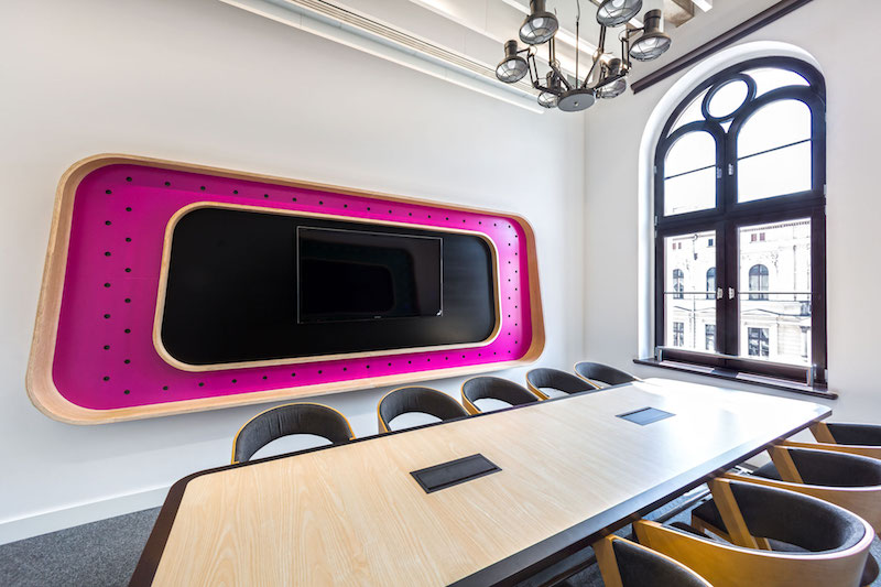 Opera office meeting room with colored wall decor