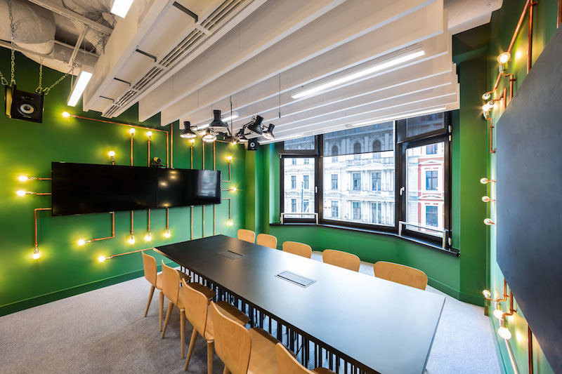 Opera office metting room with green walls and pipes