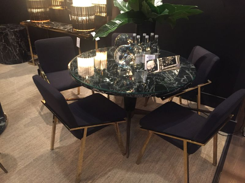 round-dining-table-with-chairs-that-has-a-gold-frame