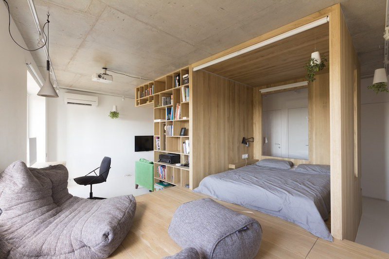 Small Studio Organized Around A Wooden Box Volume