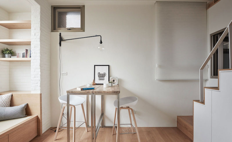 Small apartment loft in Taipei table and lamp