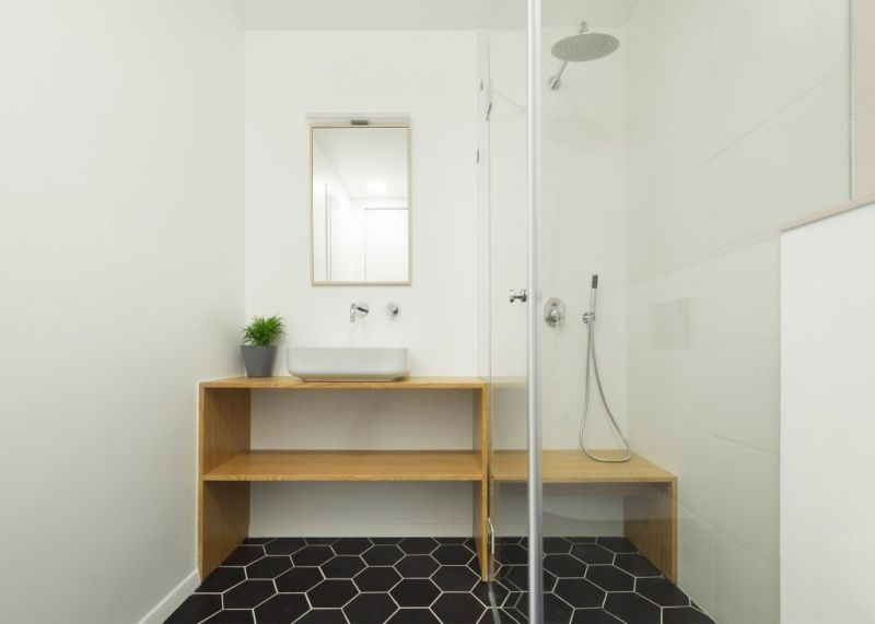 Tel Aviv apartment renovation bathroom hexagonal tiles