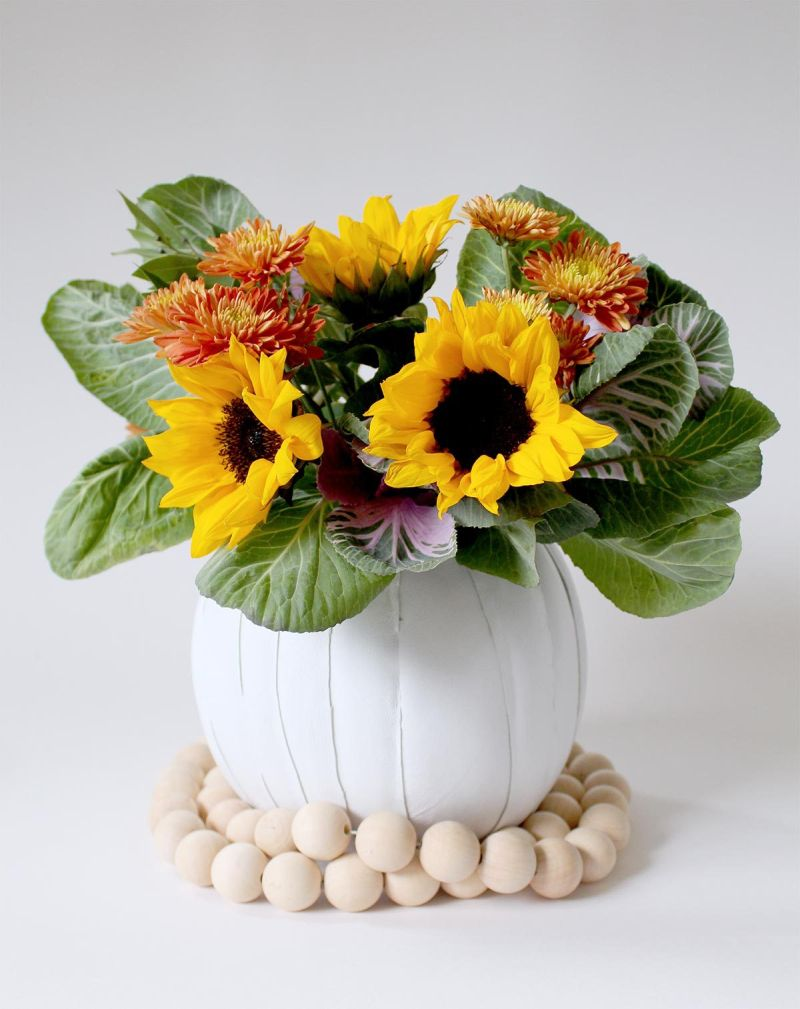 Turning a pumpkin into a flower vase