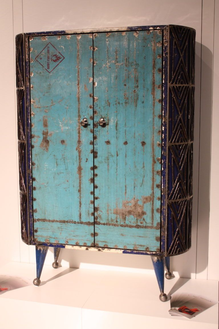 The recycled metal in his colorful armoire provides extra visual details.