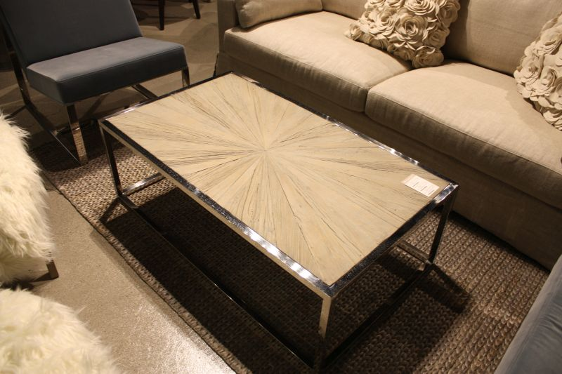 Wood coffee table top with a sunburst and chrome base