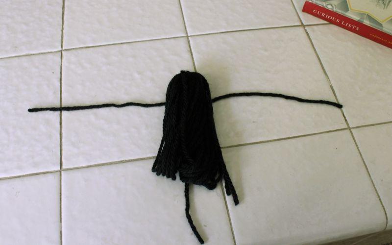 cut length of black yarn