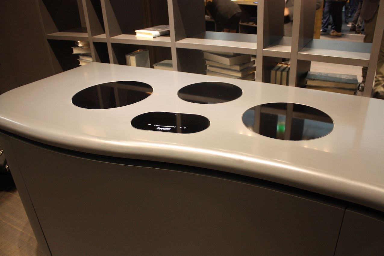 Aran's induction cooktop has designated burner areas that are sleek and modern.