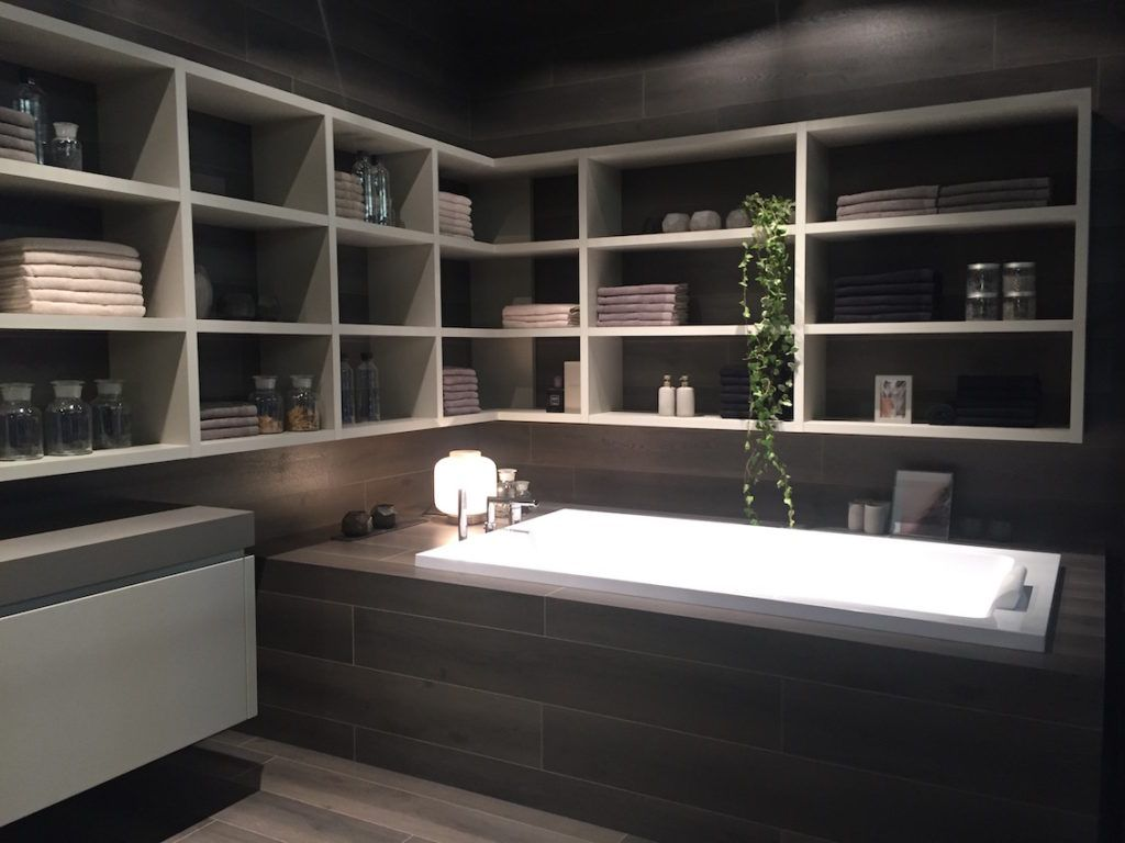 Open shelving above the tub makes the most of a bathroom corner.