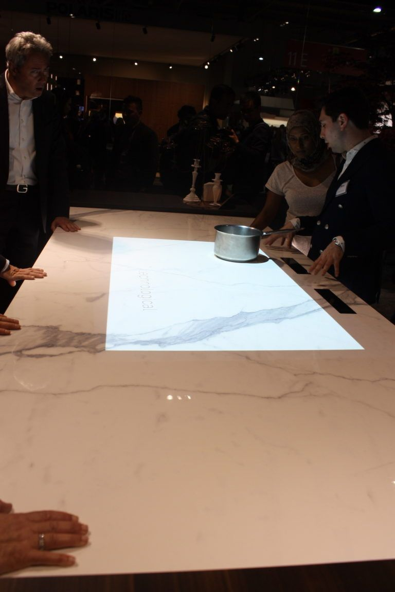 Binova has another version of the invisible cooktop that looks like a marble island.