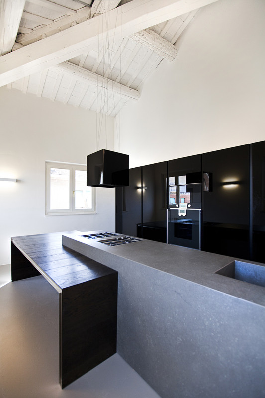 Black kitchen and concrete kitchen for a loft