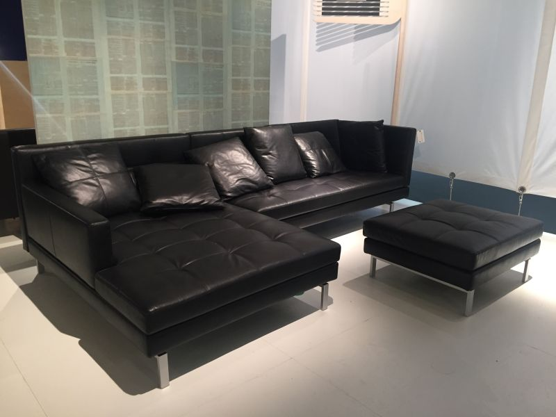Black leather l shaped sofa and ottoman
