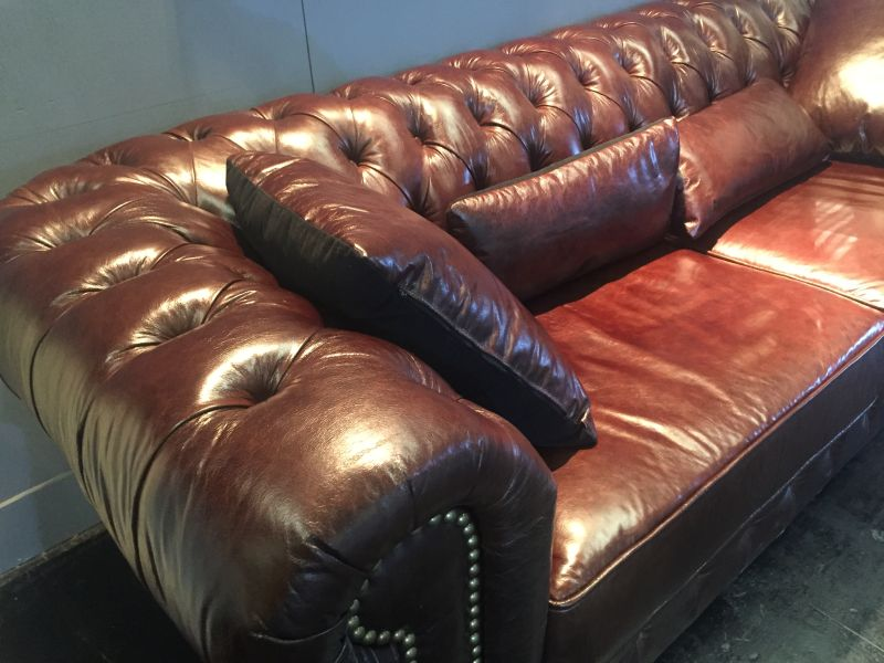 Brown leather tufted sofa couch