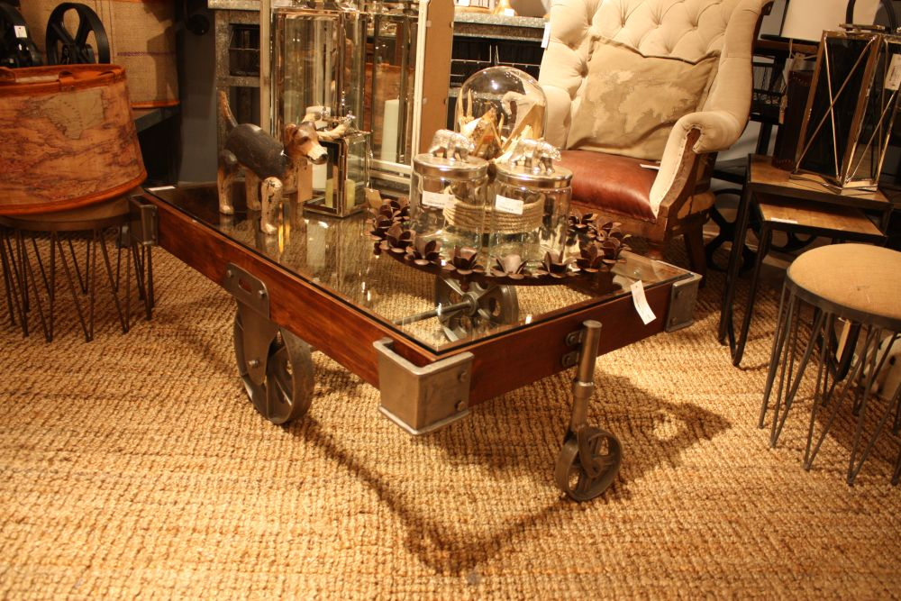 Coffee table on wheels with an industrial design