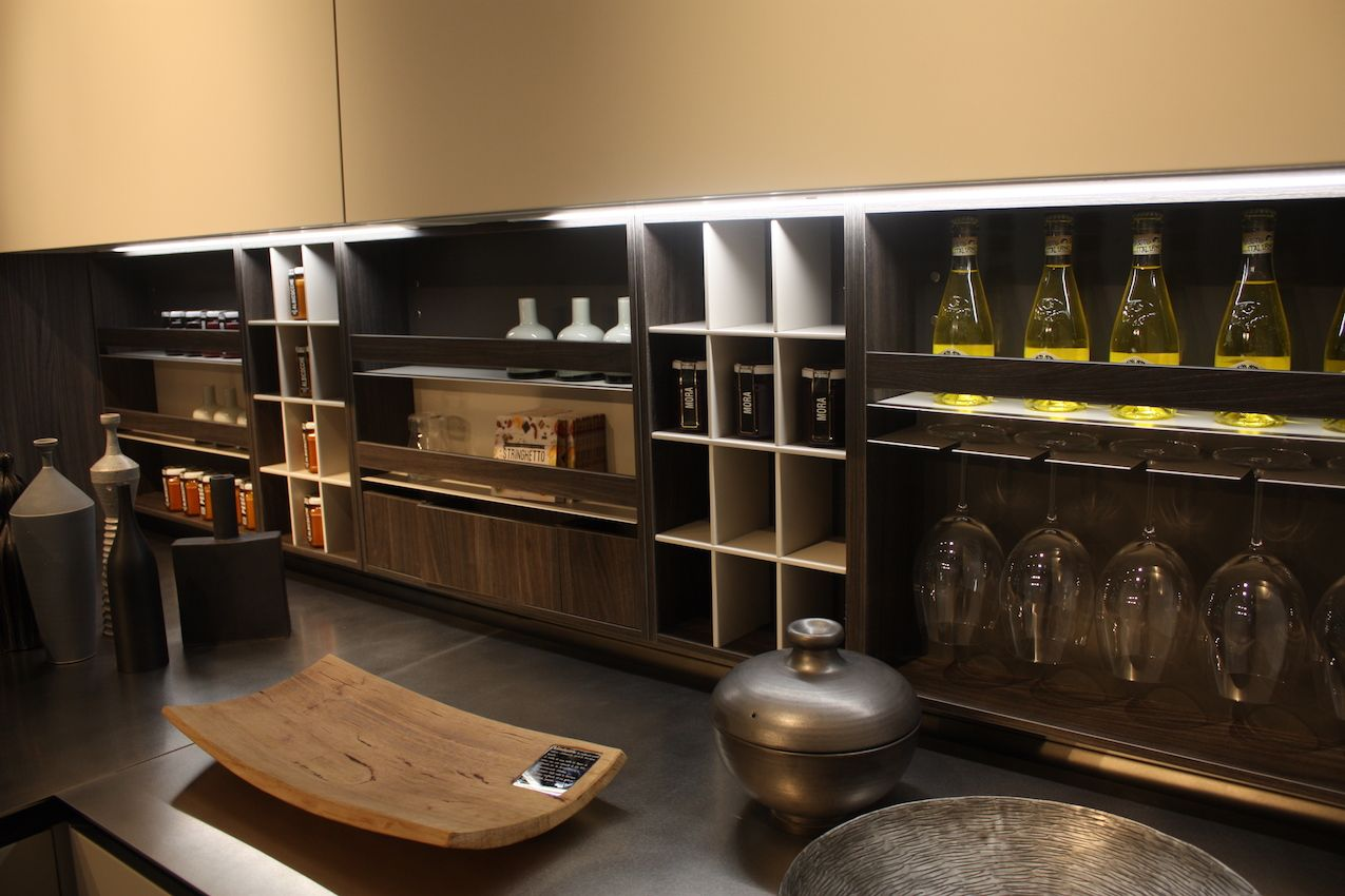 This modular version includes hanging racks for stemware, shelving and cubby holes.