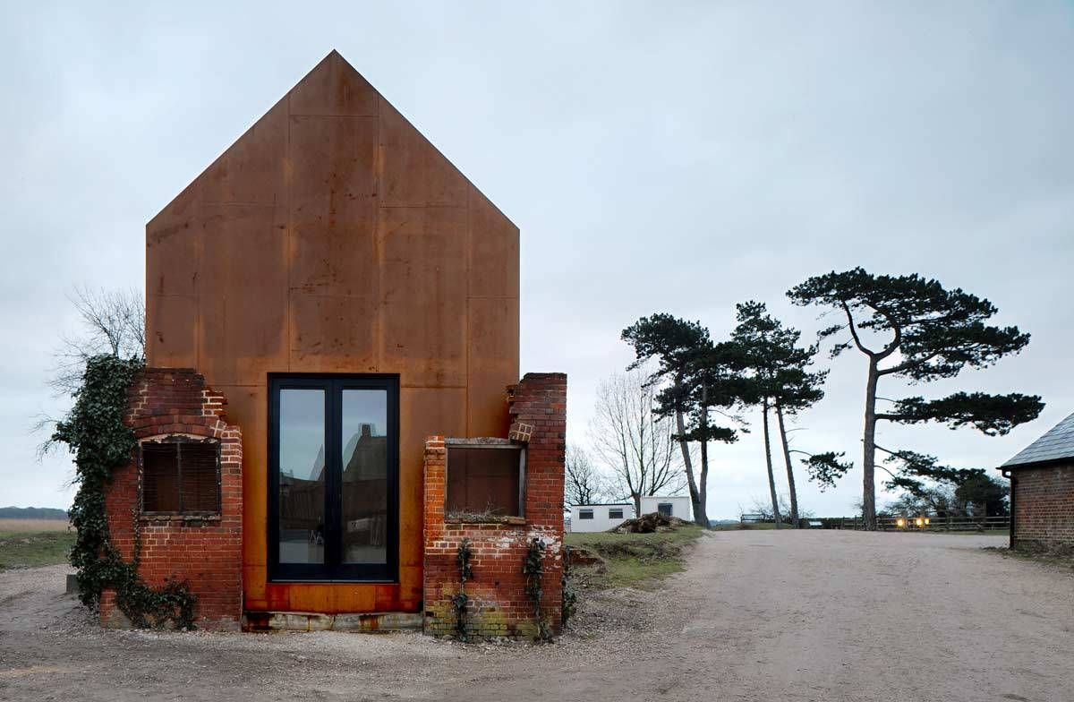 Corten dilapidated building on the Dovecote Studio