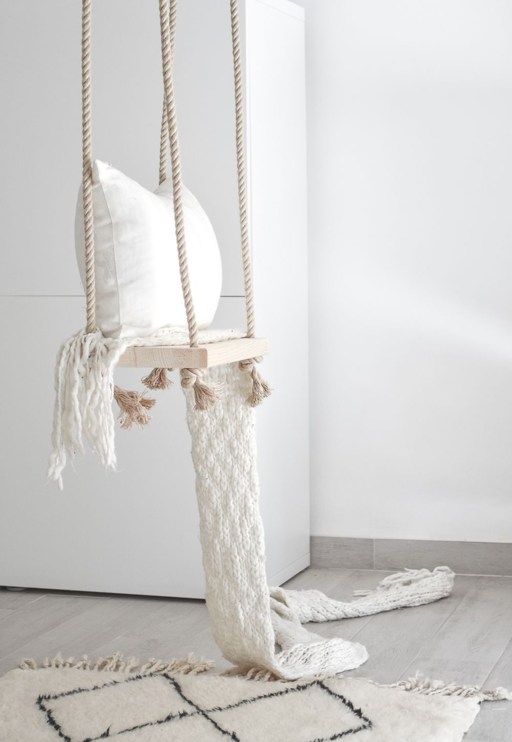 a dreamy indoor swing adds style and serenity