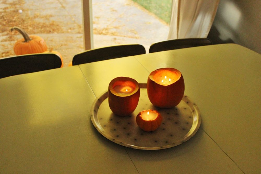 DIY Pumpkin Candles on Table