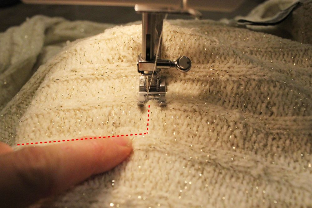 Directly outside the straight-stitch seam