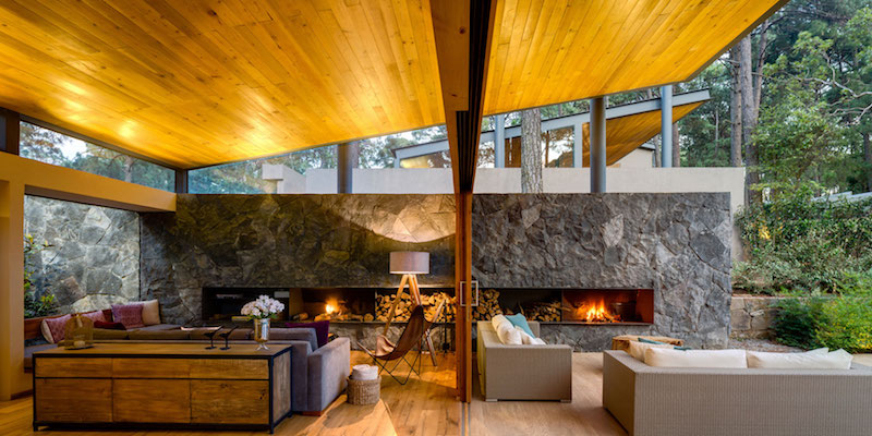 Five Houses condominium fireplace connects spaces