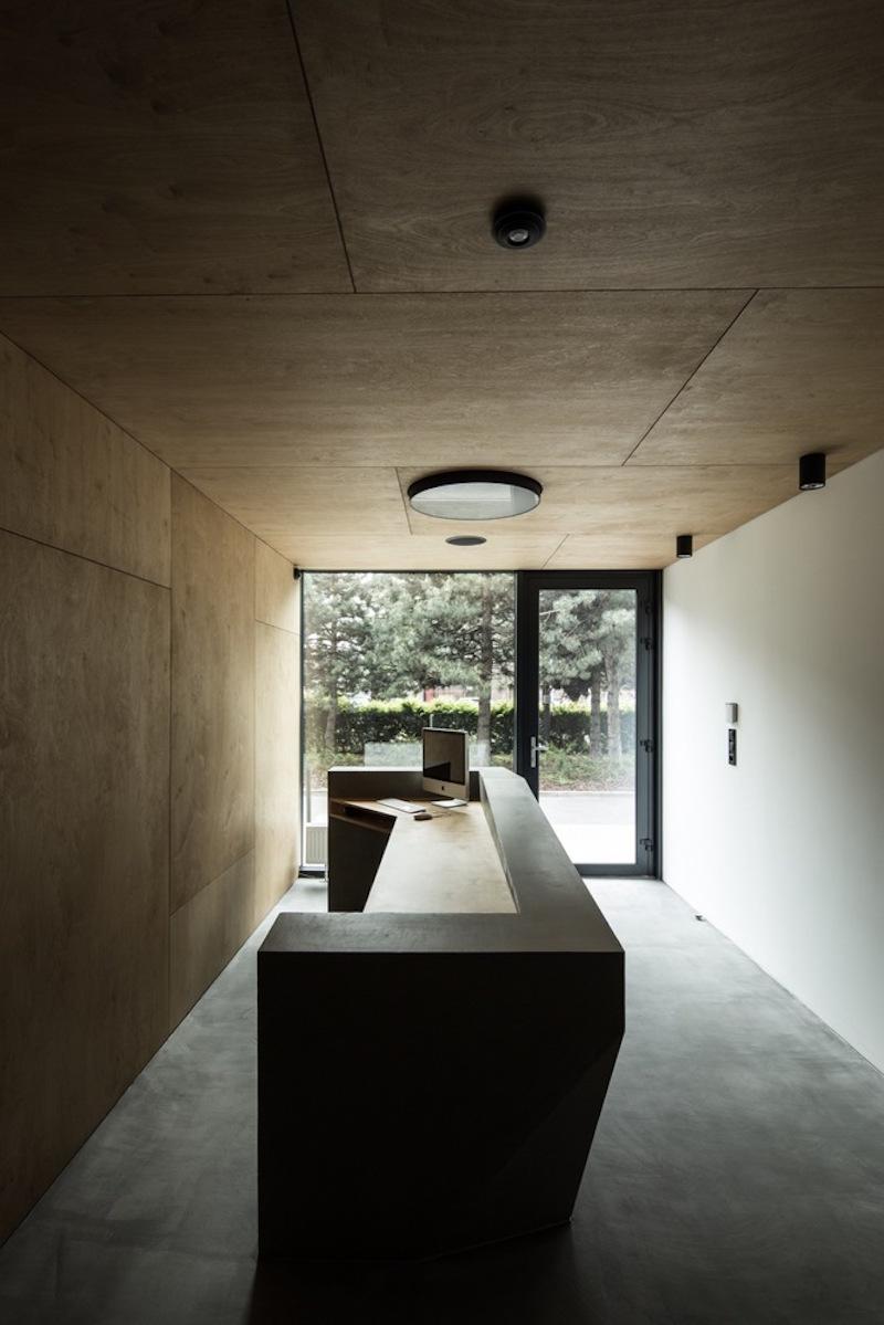 Framehouse office cocrete reception desk
