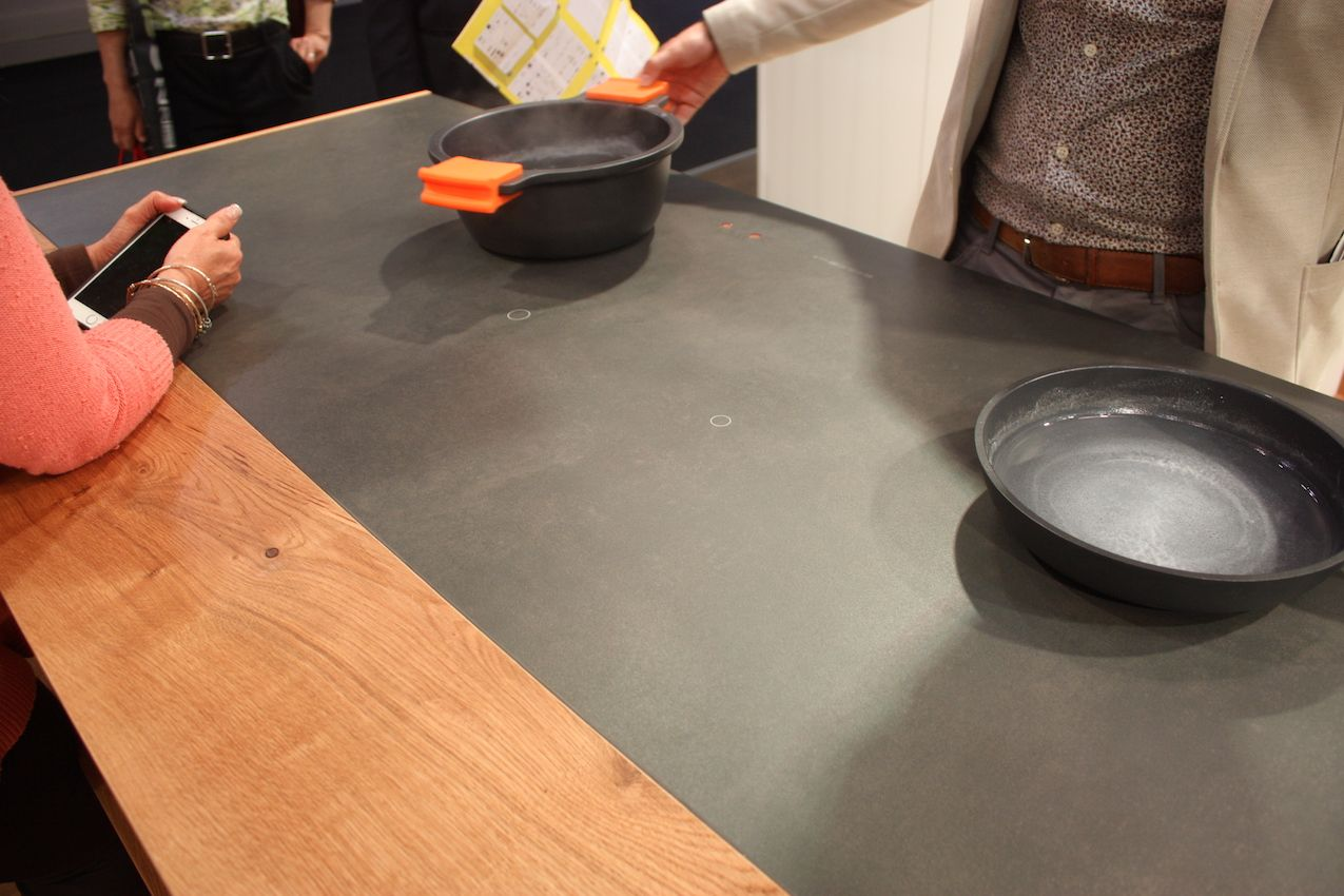 Gatto has an induction cooktop that has a perfectly smooth surface and no knobs.