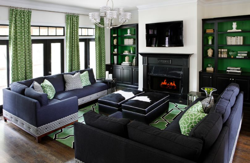 Green living room with black cowhide ottomans