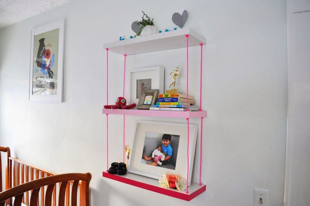 Hanging ombre shelves with pink rope