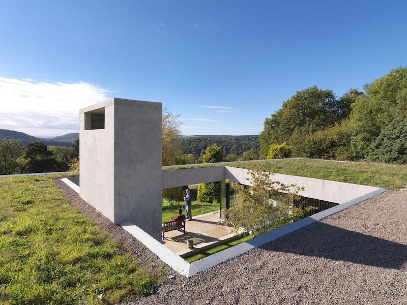 Inside Outside house green roof and hillside