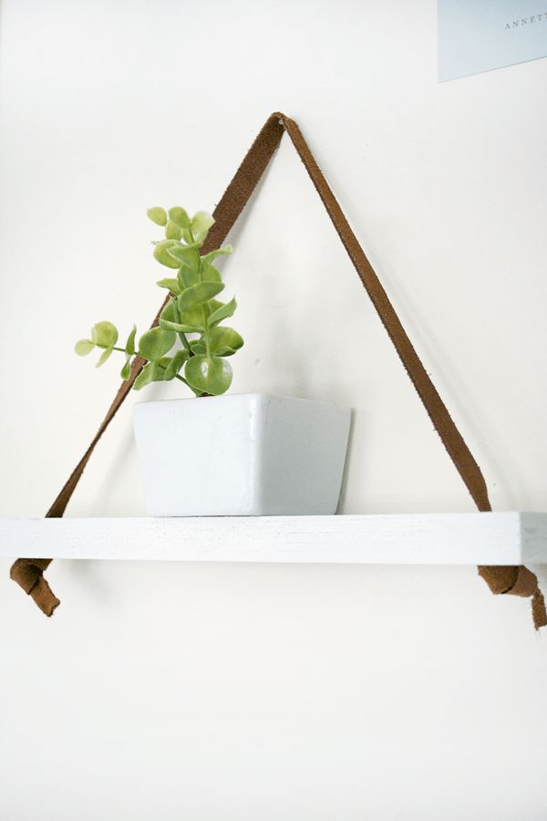 Leather strap hanging shelf