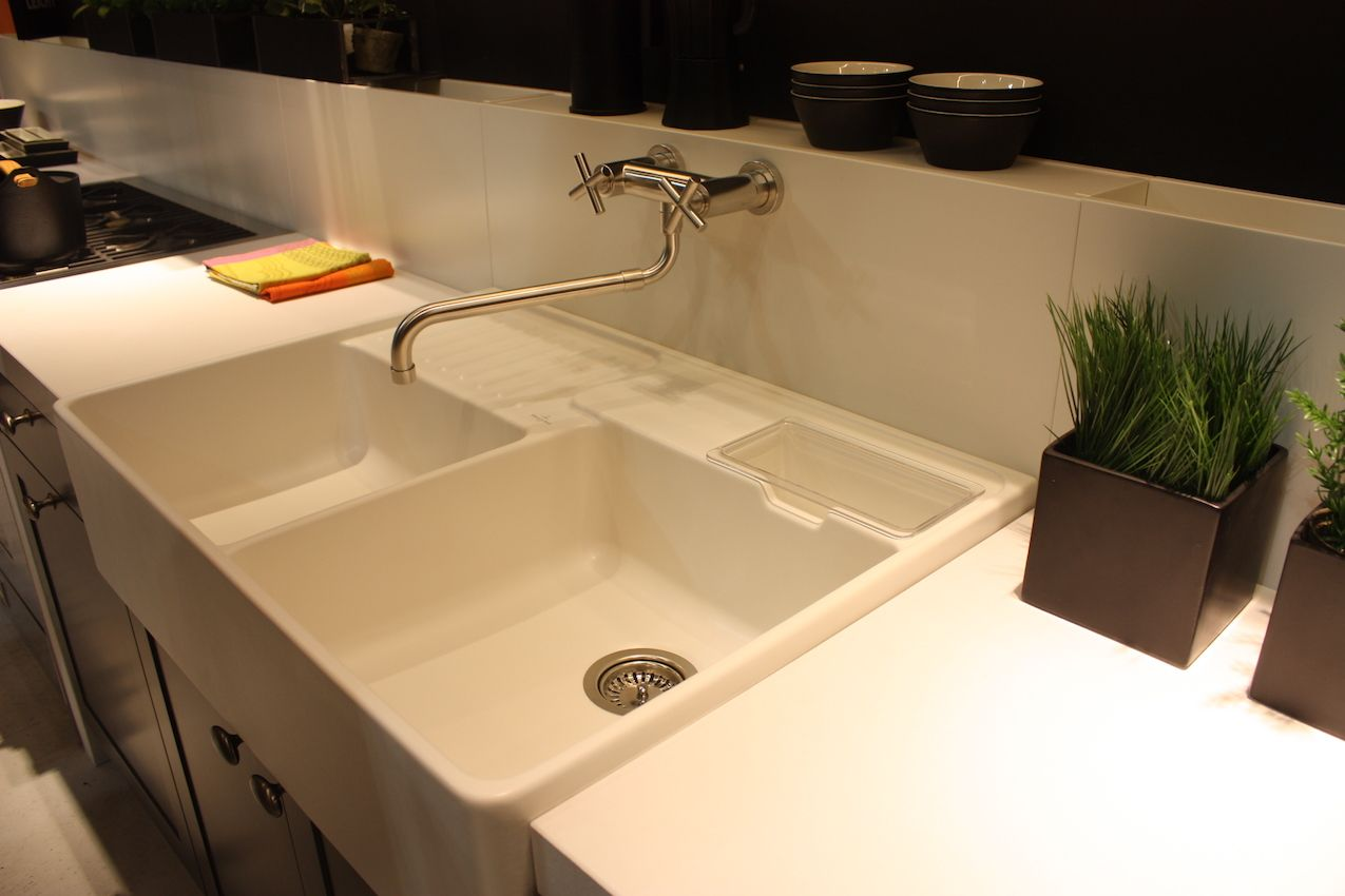 Leicht's multi-compartment sink includes a long, wall-mounted faucet with old-fashioned knobs.