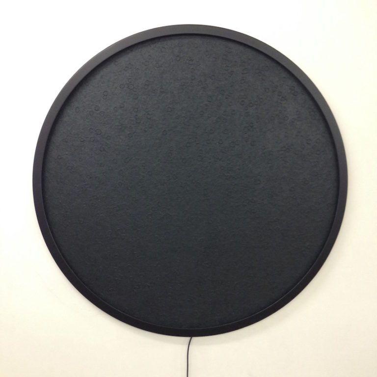When unlit, the Luna looks like a dark, textured circle.
