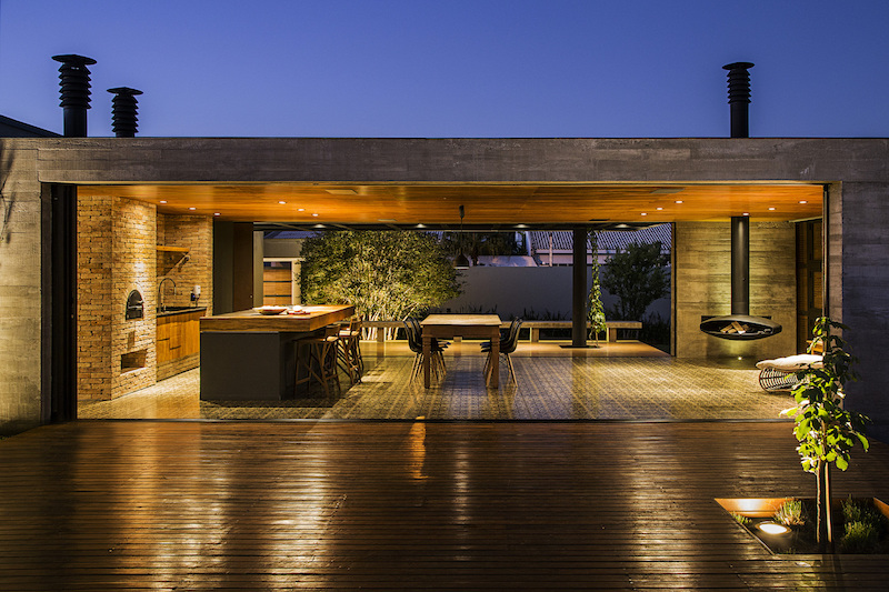 Contemporary House With A Folding Wood Facade And Interior Garden