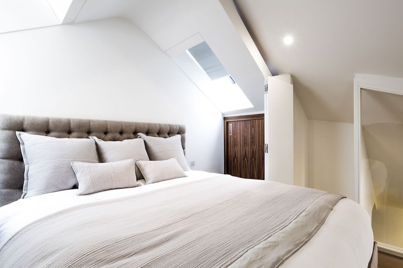 Penthouse apartment in church master bedroom skylight
