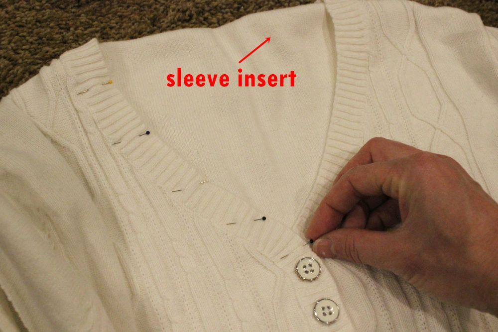 Pin the flattened sleeve to the v-neck