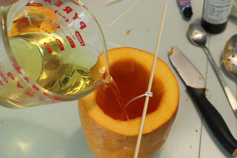 Pour the hot wax into your pumpkin